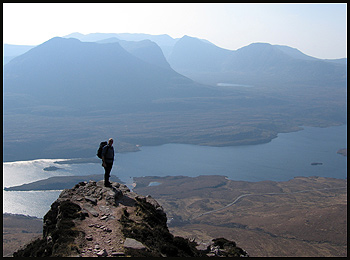 Dave on a pinnacle overlooking the rough hills of Coigach, with delightful little Beinn an Eoin in the foreground