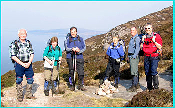 From left to right - Barry, Julie, Andrew, Pam, Dave and Paul - in a jolly mood as they set off along the lovely coastal path to Scoraig in the sun on a day that forecast rain