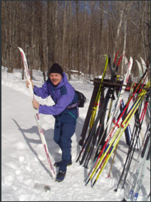Ken waxes his skis outside Lusk Cabin