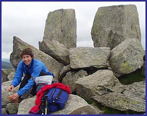 Sue repairs her feet at the summit of Tryfan