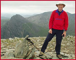 After the last big climb, Martin is happy to be on the summit of Pen yr Ole Wen, with Tryfan behind